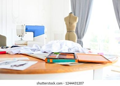 Sewing machine, dummy and other sewing equipment in the desighners workplace