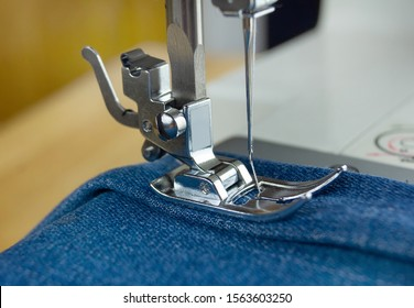 Sewing machine with fabric and thread, close-up