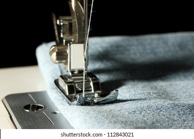 Sewing machine with jeans closeup