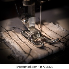 Sewing machine and a linen rag. Focus on the needle.