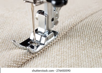 sewing machine makes a seam on fabric. sewing process