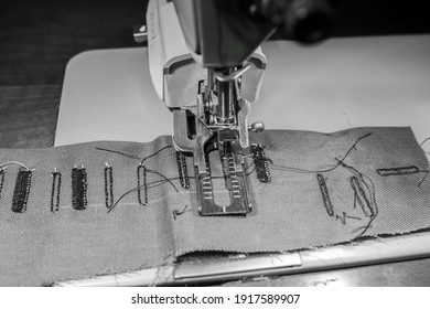 Sewing machine making button holes in Black and white