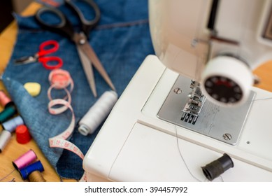 sewing machine, needle, scissors and sewing tools