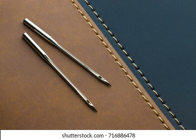 sewing machine needles for leather on dark brown leather stitched with black leather using yellow thread