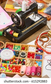 sewing machine and set of accessories to embroidery, haberdashery, sewing accessories top view, seamstress workplace, many object for needlework, handmade and handicraft