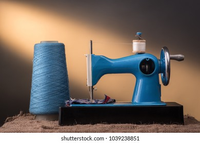 Sewing machine, thread and ray of light