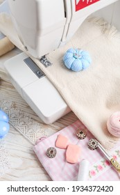 Sewing machine, tools and supplies. Hobby, crafting, creativity, free time at home concept.