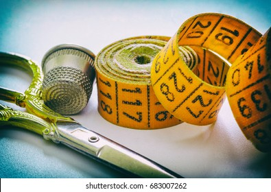 Sewing measuring tape scissors and thimble accessories for needlework and sewing, hobby, white background, retro style
