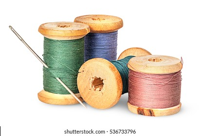 Sewing needle and multicolored thread on wooden spool isolated on white background