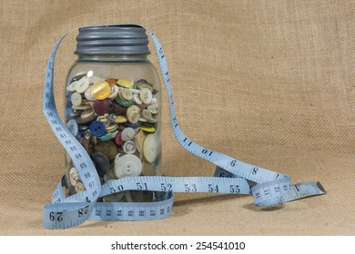 Sewing notions background jar of buttons