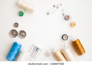 Sewing notions (tools) on a white ground