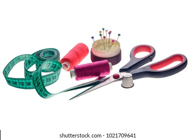 sewing objects, threads, needles, scissors on white background isolated