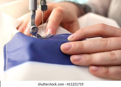 Sewing on a machine.Woman sewing on the sewing machine