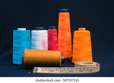 Sewing Supplies on black fabric background