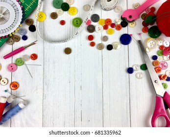 Sewing supplies on a rustic white wood surface with copy space