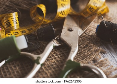Sewing Thimble. Needle and thread. Scissors and a centimeter are the tools of a tailor, fashion designer, seamstress