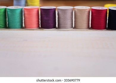Sewing thread and accessories on white background.