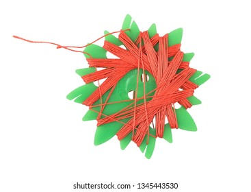Sewing thread on white background