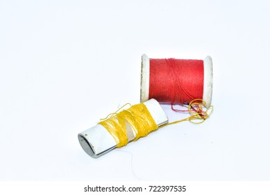 Sewing thread on the white background