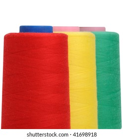 Sewing thread. Red, yellow and green colour.