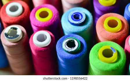Sewing threads as a multicolored background closeup