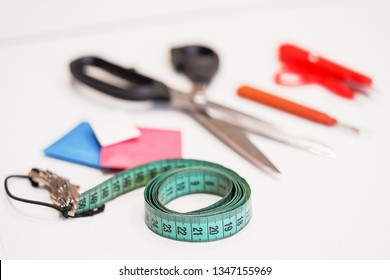 Sewing threads with needles, pins, fabric, buttons and sewing centimeter