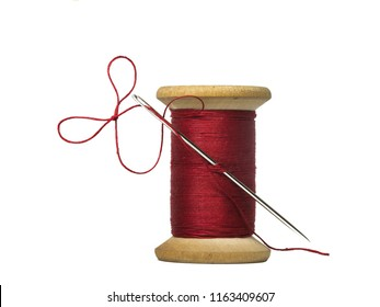 sewing threads spool with sewing needle  isolated on white background
