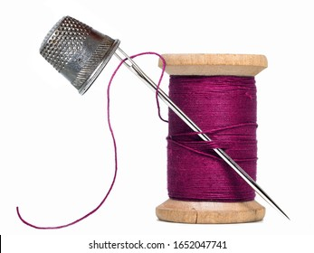 sewing threads spool with sewing needle,thimble isolated on white background