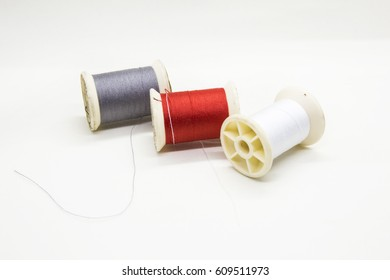 sewing threads there are many color such as red, white,gray with white background or isolated.