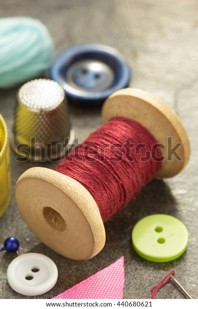 sewing tools and accessories on table background