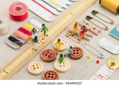 sewing tools and miniature women