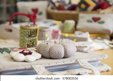 Sewing tools and quilt works on a table
