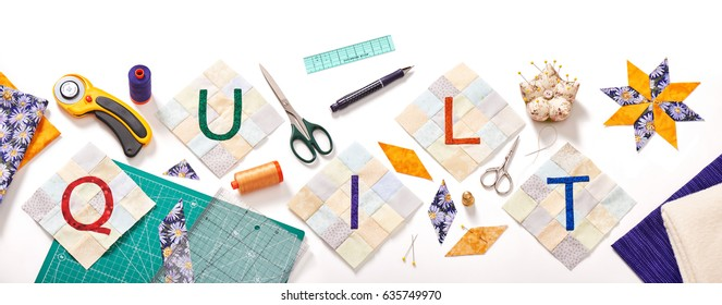sewn letters, consisting to the word quilt surrounded by accessories for patchwork