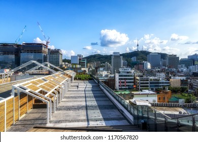 sewoon plaza rooftop park with the view of namsan tower in the distance. Taken in Seoul, South Korea. September 1st 2018