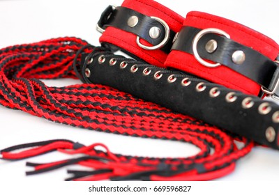 sex - handcuffs and flogger