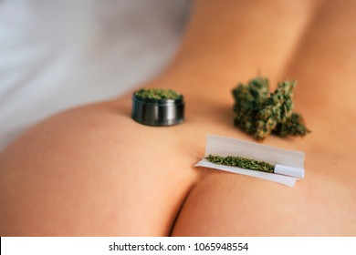 sex and marijuana. themed weed and sex. joint weed Cannabis buds on the girl's ass grinder rolled marijuana