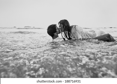 sex on the beach, young couple kissing in the water, black and white