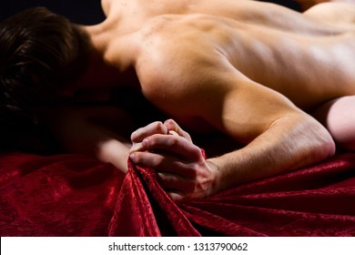 Sex and pleasure concept. Feeling of intense sexual pleasure. Hand squeeze bedclothes. Moaning in sex ecstasy. Naked lovers passionate sex. Passionate couple have sex make love. Female orgasm.