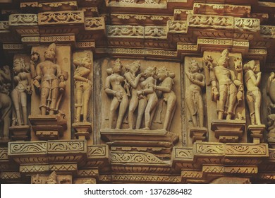Sex Poses - Close up of Kamasutra scenes on the wall of Hindu temple in western group of temple Khajuraho, India