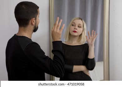 sex selection. man looks in the mirror and sees the reflection of a woman. gender identification