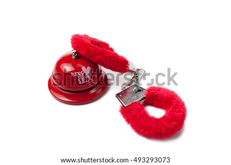 sex toys ring for sex bell with red handcuffs on isolated white background - Christmas Sex Toys