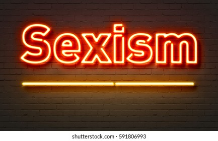 Sexism neon sign on brick wall background