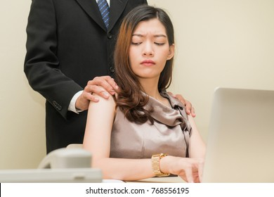 Sexsual harassment in workplace. Unhappy female employee looking at hand of boss touch at her shoulder and feeling disgusted.