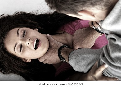 Sexual abue concept. Brutal man rapeing young woman