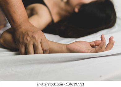 Sexual abuse is a problem or Social issues concept, Man's hand holding a woman hand for rape and sexual abuse, Hands for rape and sexual abuse concept.