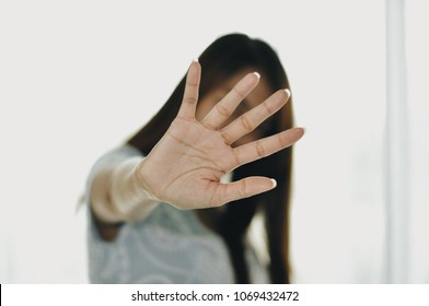 sexual abuse for women gender in society, a girl hand is stopping harassment on the bedroom of family. stop violence against Women, international women's day