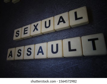 Sexual Assault, word cube with background.