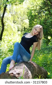 sexual and beautiful blonde in wood