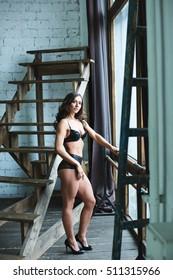 Sexual bodybuilder. Beautiful fitness woman in lingerie.