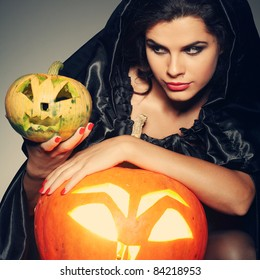 Sexual brunette in the suit of witch in night of Halloween